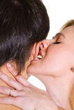 Young woman biting young man ear. Royalty Free Stock Image
