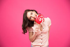 Young woman bitting lollipop Stock Image