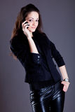Young woman in black Royalty Free Stock Image