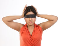 Young woman with black band. Young woman tying  black band to her eyes Stock Photography