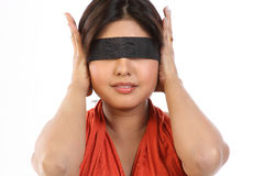 Young woman with black band. Young woman tying  black band to her eyes Stock Photos