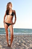 Young woman in black bikini on sky background Stock Images
