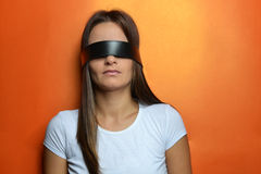 Young woman with the black blindfold Stock Photos