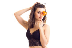 Young woman in black bra with candy Stock Photo