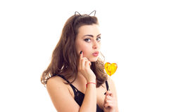 Young woman in black bra with candy Stock Images