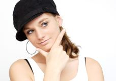 Young woman with black cap Royalty Free Stock Photos