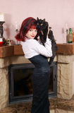 Young woman with black cat Stock Image