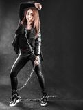 Young woman in a black clothes with a chain Stock Image