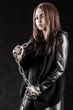Young woman in a black clothes with a chain Royalty Free Stock Image