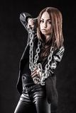 Young woman in a black clothes with a chain Royalty Free Stock Photos