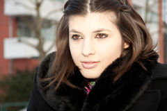 Young woman with a black coat Royalty Free Stock Photos