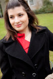 A young woman with a black coat Royalty Free Stock Photos