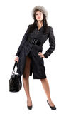 The young woman in a black coat and a fur cap Royalty Free Stock Image