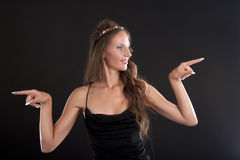 A young woman in a black dress Stock Photo
