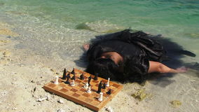 Young Woman In Black Dress With Board Of Chess stock video