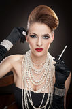 Young  woman in black dress and gloves Royalty Free Stock Photo