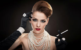 Young  woman in black dress and gloves Stock Photo