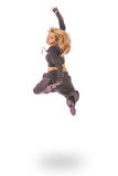 Young woman in black dress jumping Royalty Free Stock Images