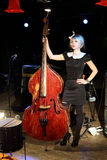 Young woman in black dress with wooden contrabass Royalty Free Stock Images