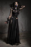 Young woman in black fantasy costume Royalty Free Stock Images