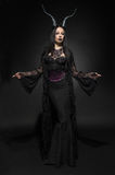 Young woman in black fantasy costume royalty free stock photography