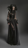 Young woman in black fantasy costume Stock Photos