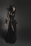Young woman in black fantasy costume Royalty Free Stock Image