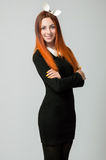 Young woman in black fitting dress and white rabbit ears Stock Photography