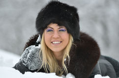 Young woman with black fur Stock Photos