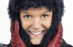 Young woman in black furry winter hat Stock Photo