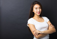 Young woman with black ground Stock Images