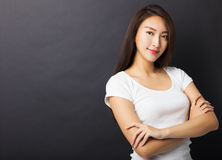 Young woman with black ground Stock Photography
