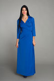 Young woman with black hair in a blue dress Royalty Free Stock Photography