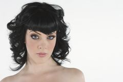 Young Woman With Black Hair And Blue Eyes Stock Photo