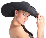 Young woman with black hat Stock Photography