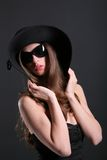 Young woman in the black hat Stock Image