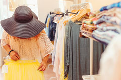 Young woman in black hat shopping in women store. Shopping time. Summer sale. Stock Image