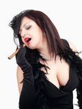 Young Woman with Black Hat Smoking Cigar Stock Photos