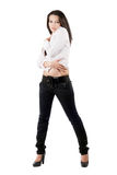 The young woman in black jeans Stock Photos