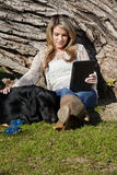 Young Woman with Black Labrador Dog in Park stock image