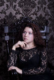 Young woman in the black lace dress Stock Images
