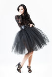 Young woman in black lace dress and heels royalty free stock image