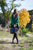 Young woman with black leather handbag standing in Royalty Free Stock Photos