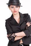Young woman with black leather hat Stock Photo