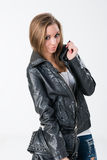 Woman in black leather jacket Royalty Free Stock Image