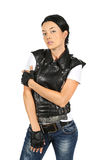 Young woman in a black leather vest Stock Images