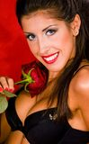Young woman in black lingerie with red rose Stock Photo