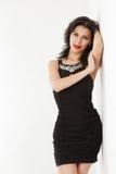 Young woman in black mini dress Stock Photos