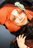 Young woman in black and orange turban Royalty Free Stock Photo