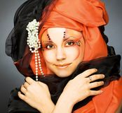 Young woman in black and orange turban Royalty Free Stock Photography